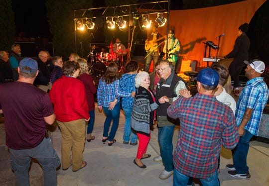 Guests enjoy dancing to the band Jelly Bread at Saturday night's Taste of the Valley Festival.