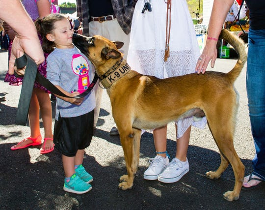 Borys, a K-9 belonging to Deputy Sheriff Wayne Hawley, greets Mia Harrington, 4, of Stagecoach.