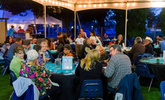 Guests enjoy dinner and conversation at Saturday night's Taste of the Valley Festival.