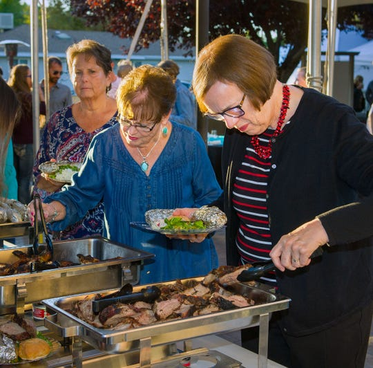 Guests enjoy a dinner highlighting the crops and agriculture of the valley.
