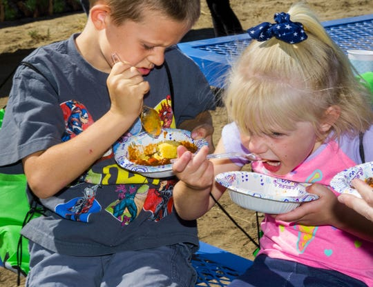 Noah Manning, 7, and Cora Manning, 4, of Carson City, sample entries in the Dutch oven chili competition.