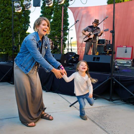 Angie Whittemore, 4, dances with her mother Tiffany at Saturday's Taste of the Valley Festival.