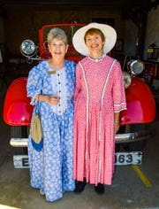 Mabel Masterman, left, past president and current secretary of the Historical Society of Dayton Valley, and Martha Lewis, firehouse and jail docent, have their photo taken in front of a historic fire truck.