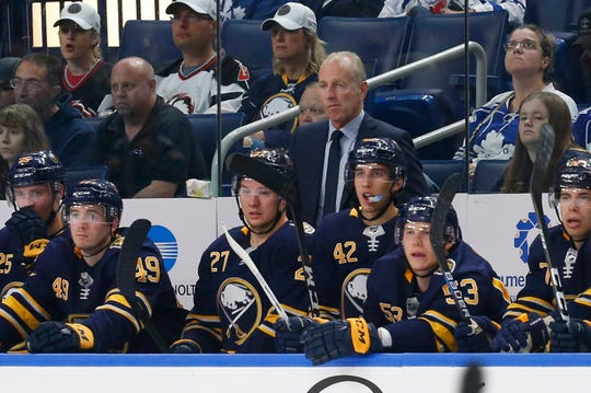 Buffalo Sabres coach Ralph Krueger watches during the third period of the team's NHL preseason hockey game against the Toronto Maple Leafs. Krueger has worked hard establishing communication line with Rochester coach Chris Taylor.