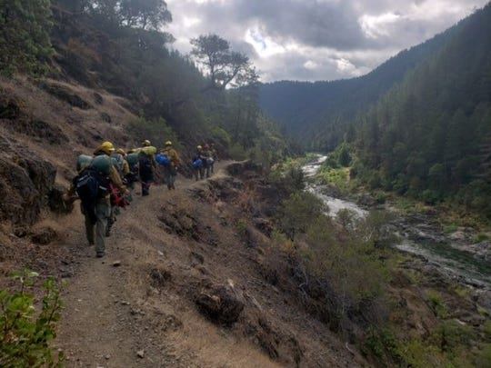 Fire teams hiked into the Rogue River canyon to put out a small wildfire.