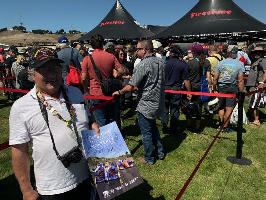 "Retiree John Gay of Salinas joined hundreds of fellow IndyCar enthusiasts who waited more than two hours for autographs from their favorite drivers Sept. 20, 2019. ""They've been gone too long,"" Gay said about the 15-year gap since the fastest series in racing competed at the Firestone Grand Prix of Monterey at WeatherTech Raceway Laguna Seca. ""I've been coming here since 1992 and I'm so glad they're back,"" Gay said. As evidence of his enthusiasm, Gay said he has a checkered flag signed by 32 winners of the Indianapolis 500, representing 55 wins at the 500."