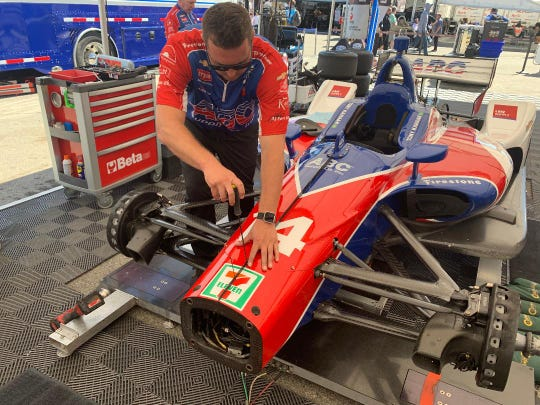 "Shelby Tracey, a 2005 graduate of Salinas High School, installs a shock cover on AJ Foyt Racing's No. 14 driven by 2013 Indy 500 winner Tony Kanaan at the Firestone Grand Prix of Monterey at WeatherTech Raceway Laguna Seca Sept. 21, 2019. Tracey, 32, grew up in Monterey and joined Foyt's team as a mechanic in January after years working for other IndyCar and sports car teams. The son of a Laguna Seca track volunteer, Tracey said he was thrilled IndyCar returned to the world-famous track after a 15-year absence. ""I wish they had never left,"" he said. Kanaan finished 16th."