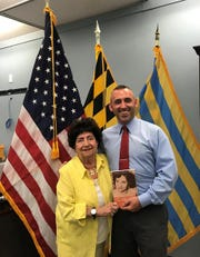 "Anna Foultz presents Salisbury Mayor Jake Day with a copy of her book, ""Two Steps Forward, A Memoir,"" at his office in Salisbury earlier this year."