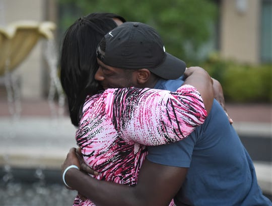 Salisbury University football player Octavion Wilson hugs his mother Teresa.