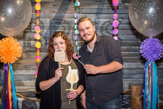 Revelers pose for a photo at Tastefully Childish, a fundraiser to benefit Above & Beyond Children's Museum in Sheboygan.