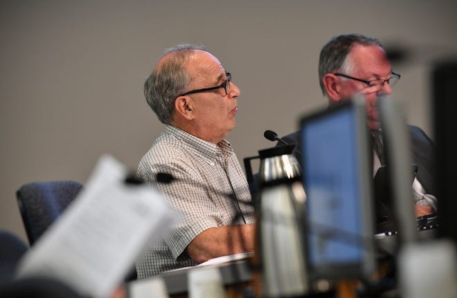 City council member George Hontos speaks during a city council meeting in July.