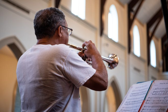 Trumpeter Dr. Longineu Parsons, member of the musical duo Duo Paloma, warms up at a Sunday rehearsal.