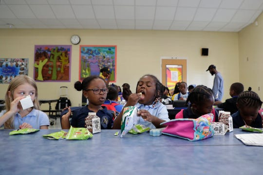 Apalachee Elementary School students in the after-school program eat snacks in the cafeteria Monday, Sept. 23, 2019. Agriculture Commissioner Nikki Fried visited the school briefly during the program to hand out snacks to the kids.