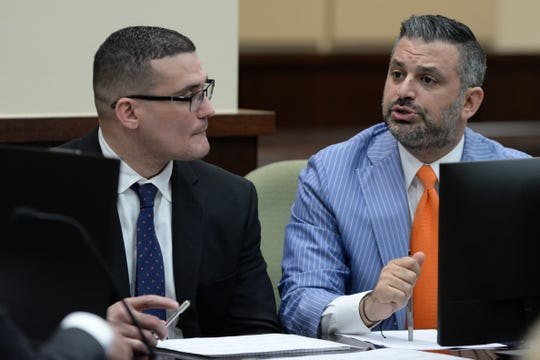 Attorney Saam Zangeneh talks with the rest of the defense team representing both Sigfredo Garcia and Katherine Magbanua who are charged in the 2014 murder of Florida State law professor Dan Markel at the Leon County Courthouse Monday, Sept. 23, 2019.