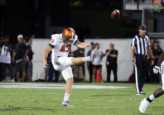 FAMU punter Chris Faddoul sends the ball deep downfield versus UCF.