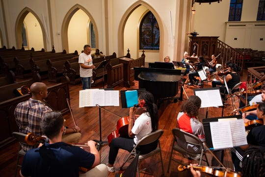 Trumpeter Longineu Parsons leads the Javacya Elite Chamber Orchestra at a rehearsal at St. Peter's Anglican Cathedral on a Sunday before the first concert.