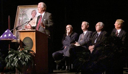 2001: Former Speaker of the House, Donald Tucker, left, shares old stories during the Dempsey Barron memorial at Gulf Coast Community College in Panama City. Si Mathison, middle left, Marvin Urquhart, Sen. Phil Lewis and Sen. James Scott look on.