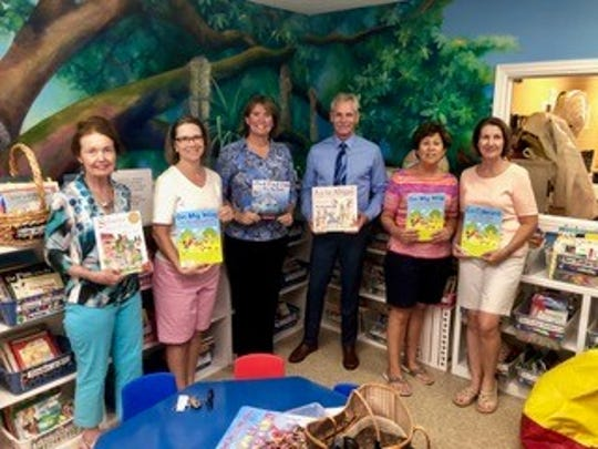 The Children's Services Council of Martin County recently gave $5,000 of a $10,000 Walmart Foundation grant to Caring Children Clothing Children to buy curriculum materials for its Reading on Wheels program, which is lead by retired teacher Betty Mulligan. Pictured are, from left, Mulligan, Loreen Francescani, Laura Haase, David Heaton, Carol Allen and Jane Evans.