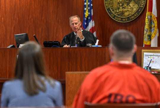 Judge Dan Vaughn (center) gestures toward murder suspect Michael Jones (right) and Assistant Public Defender Dorothy Naumann, on Monday, Sept. 23, 2019, at the Indian River County Courthouse in Vero Beach, while presiding over a hearing about showing prospective jurors photos of the crime scene and autopsy of murder victim Diana Duve for Jones's upcoming trial.