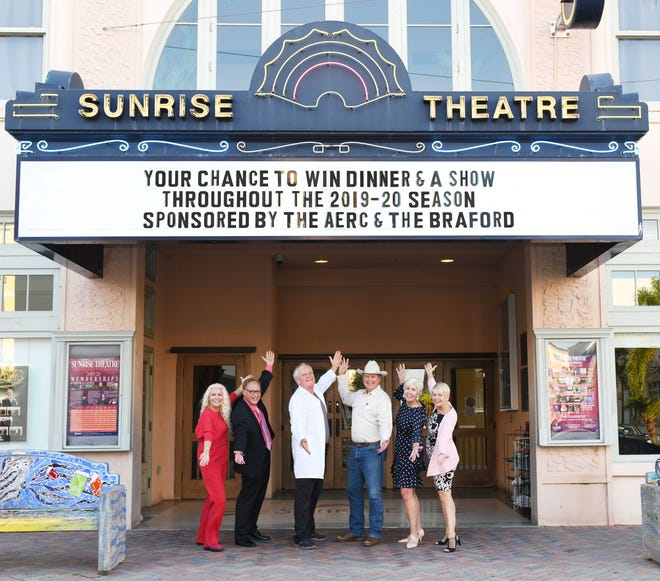 Kip Lyman, left, Scott McFall, Dr. Ron Lyman, Mike Adams, Anne Satterlee and Sharon Engel in front of the Sunrise Theatre marquee promoting the chance to win dinner and show tickets.