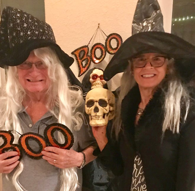 Volunteers Dick and Mary Weden get caught up in decorating plans for the first Backus Boo Ball on Oct. 26 at the Backus Museum in Fort Pierce.