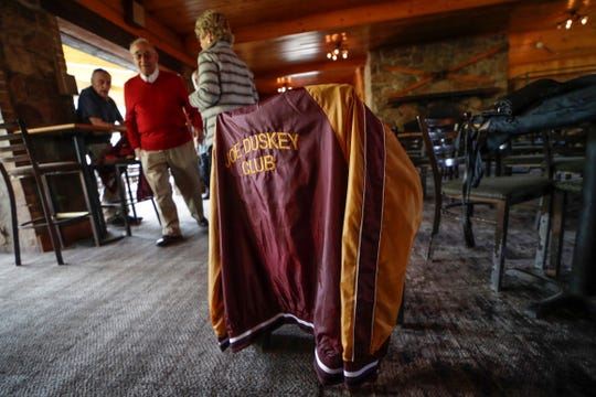 A Joe Duskey Club jacket hangs on a chair during a gathering Friday, Sept. 6, 2019, at the Granite Peak Ski Chalet in Wausau, Wis. T'xer Zhon Kha/USA TODAY NETWORK-Wisconsin
