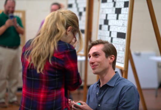 Brendan McGrady surprised his girlfriend, Amanda Yesnowitz, with a crossword-based marriage proposal at the 22nd Westchester Crossword Tournament at Westchester Table Tennis Center in Pleasantville on Sept. 20. Will Shortz, puzzle editor of The New York Times, was in on the secret.
