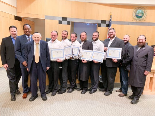 Six volunteers with Chaverim of Rockland were recognized for their efforts in the search for a man who went missing off the Virginia coast this summer during a program led by Rockland County Legislator Aron Wieder, who was joined at the podium by Legislators Toney L. Earl, Itamar Yeger, Phil Soskin and Alden Wolfe. The honorees:Moshe Herzog, Shlomo Morris, Josef Margaretten, Yedidya Blau, Yitzy Stern and Mordechai Grinberger.