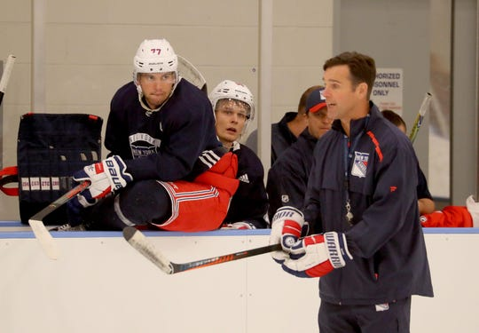 Tony DeAngelo listens to coach David Quinn as he practices with the Rangers at the team's practice facility in Greenburgh Sept. 23, 2019. DeAngelo, who practiced with the team for the first time this pre-season, had been holding out for a new contract.