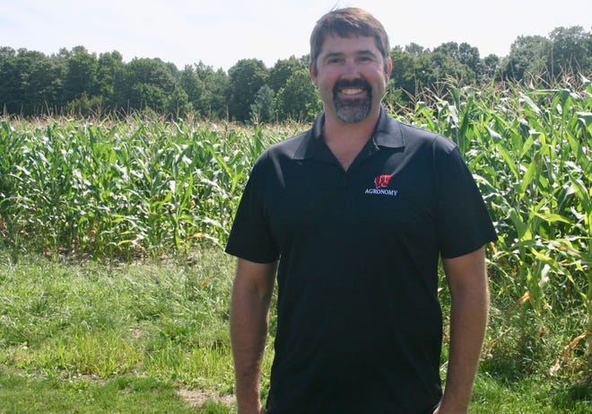 Soybean specialist Dr. Shawn Conley also checked out a cornfield during the recent crop tour in Marathon County.