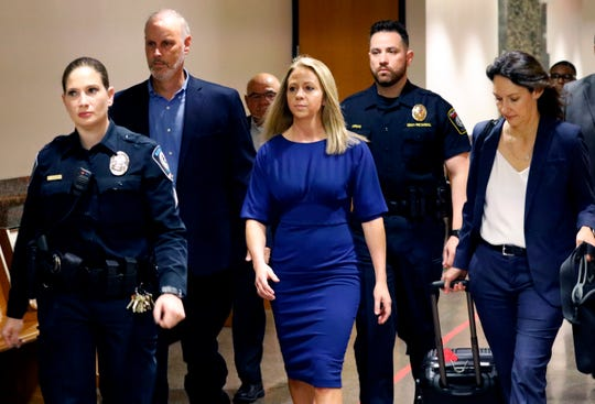 Former Dallas police officer Amber Guyger, center, arrives for the first day of her murder trial in the 204th District Court at the Frank Crowley Courts Building in Dallas, Monday, Sept. 23, 2019. Guyger is accused of shooting her black neighbor in his Dallas apartment.