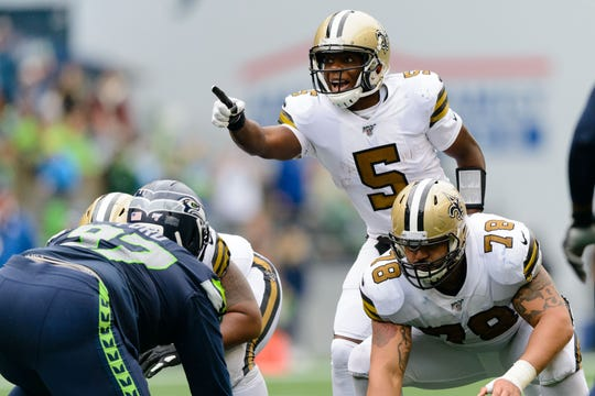 New Orleans Saints quarterback Teddy Bridgewater (5) points to the Seattle Seahawks defense during the second half at CenturyLink Field.