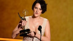 Phoebe Waller-Bridge accepts the award for Outstanding Writing For A Comedy Series during the 71st Emmy Awards. She also won best comedy actress.