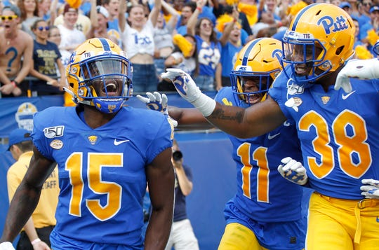 Pittsburgh defensive back Jason Pinnock (15) celebrates with teammates after an interception against Central Florida.