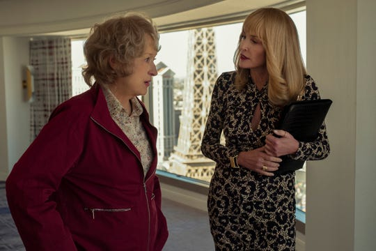 """Ellen (Meryl Streep, left) gets bamboozled by a Las Vegas real estate agent (Sharon Stone) in """"The Laundromat."""""""