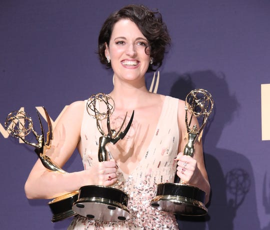 "Phoebe Waller-Bridge, winner of the awards for outstanding lead actress in a comedy series, outstanding comedy series, and outstanding writing for a comedy series for ""Fleabag,"" poses in the press room during the 71st Emmy Awards at the Microsoft Theater."