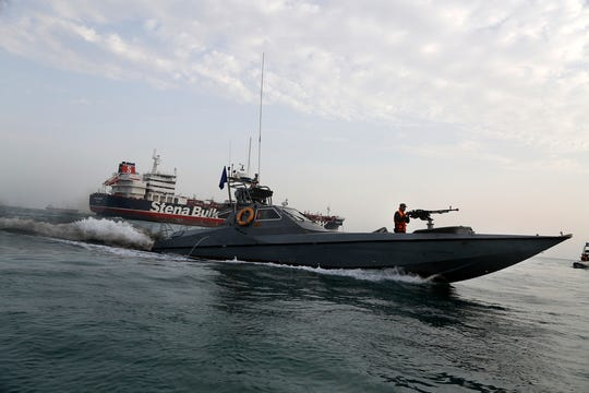 In this July 21, 2019 archive photo, a boat of the Revolutionary Guard of Iran moves around a British flagged oil tanker, the Stena Impero, which has been seized by the Guard. (Hasan Shirvani / Mizan News Agency via AP, archive)