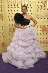 """Laverne Cox, of""""Orange Is the New Black,"""" carried a rainbow-colored purse, a nod to the LGBTQ flag, with the phrases """"Oct. 8,"""" """"Title VII"""" and """"Supreme Court."""""""