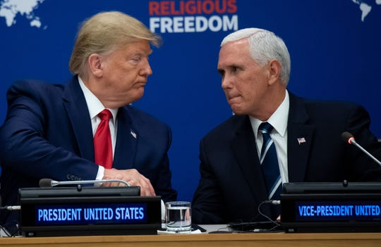 President Donald Trump shakes hands with Vice President Mike Pence at a United Nations event on Religious Freedom on Sept. 23, 2019.