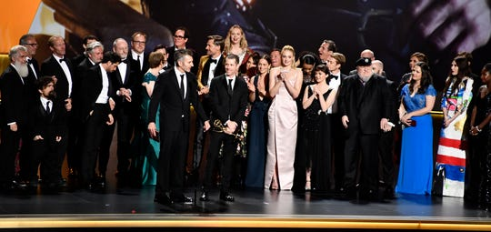 "The cast and crew of ""Game of Thrones"" on stage to accept the award for outstanding drama series."