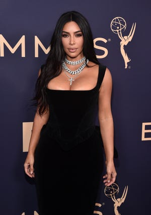 Kim Kardashian West walks the red carpet before the 71st Emmy Awards.