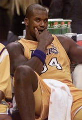 Former Los Angeles Laker Shaquille O'Neal, shown during a game in 2000, continues to hold a grudge against the reporter whose vote kept him from being a unanimous MVP.