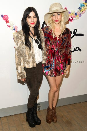 Lisa, left, and Jessica Origliasso, from the band The Veronicas, say they were removed from a Quantas Airways flight over the weekend.