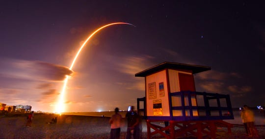 In this May 23, 2019, file photo, a Falcon 9 SpaceX rocket, with a payload of 60 satellites for SpaceX's Starlink broadband network, lifts off from Space Launch Complex 40 at Florida's Cape Canaveral Air Force Station, seen from Cocoa Beach, Fla. It's a 21st century space race: Amazon, SpaceX and others competing to get into orbit and provide internet to the earth's most remote places.
