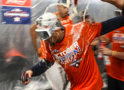 The Houston Astros celebrate after winning the AL West title.