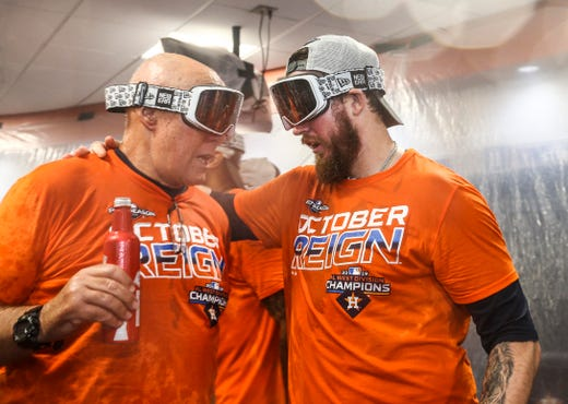 Houston Astros help pitcher Chris Devenski (right) celebrates with throwing coach Brent Stom after beating AL West.
