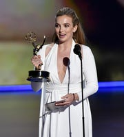 "Jodie Comer accepts the award for lead actress in a drama series for her role in ""Killing Eve."""