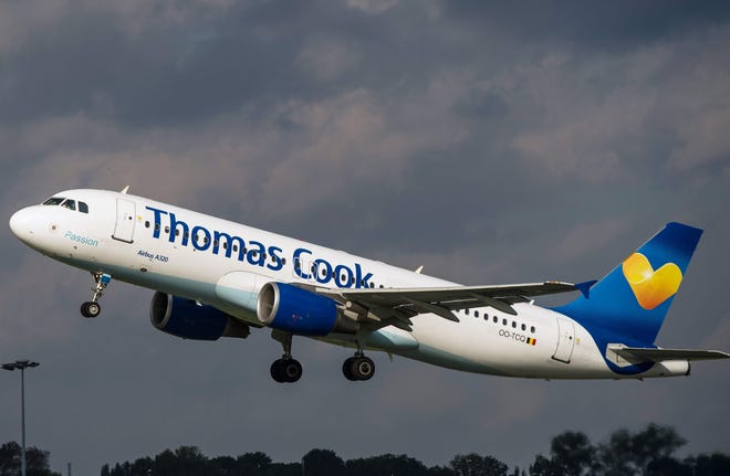 In this file photo taken on October 11, 2014 an airbus A320 of the Thomas Cook company takes off at the Lille-Lesquin airport, northern France.British travel group Thomas Cook declared bankruptcy on September 23, 2019 after failing to reach a last-ditch rescue deal, triggering the UK's biggest repatriation since World War II to bring back stranded passengers.
