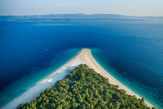 Praised as the most beautiful beach in Croatia, pine-fringed Zlatni Rat stretches into the turquoise tides of the Hvar Channel.