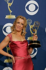 Felicity Huffman wins an outstanding leading actress in a comedy at the 57th Annual Emmy Awards on September 18, 2005 -Series.